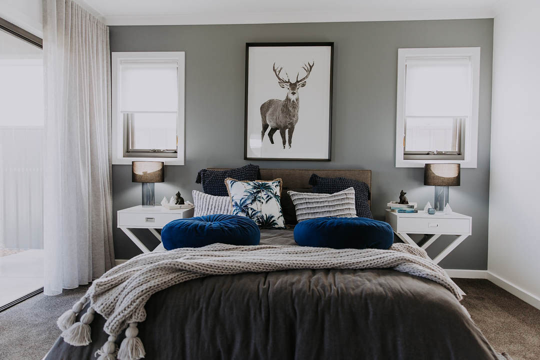 027 Alatalo Bros - display homes - north haven - bedroom - master bed - home design - interior design - blue - grey - interior decorating - new home builders - master bed- bed room design - deer art - throw rugs - cushions